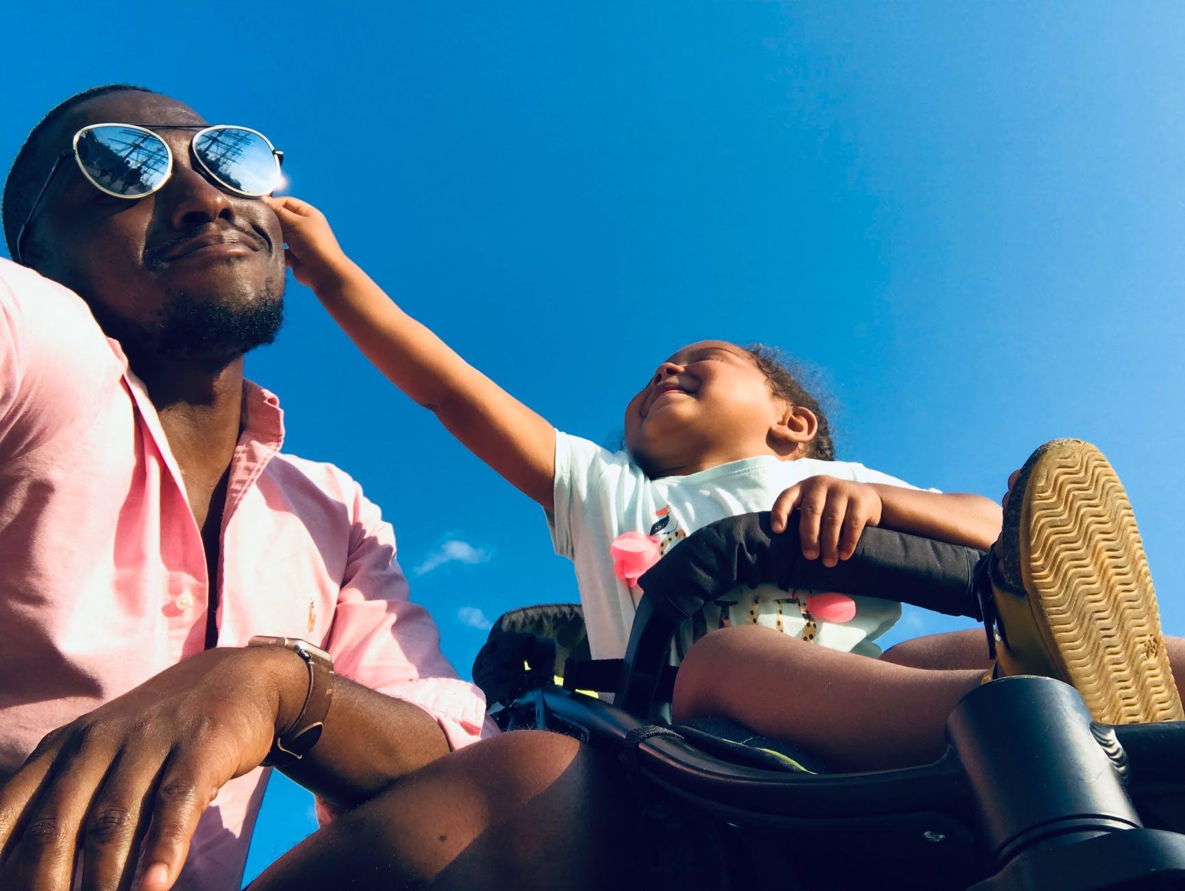 baby approaching men s black sunglasses